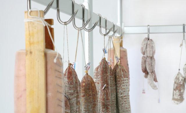 Framework with hook bar for hanging meat