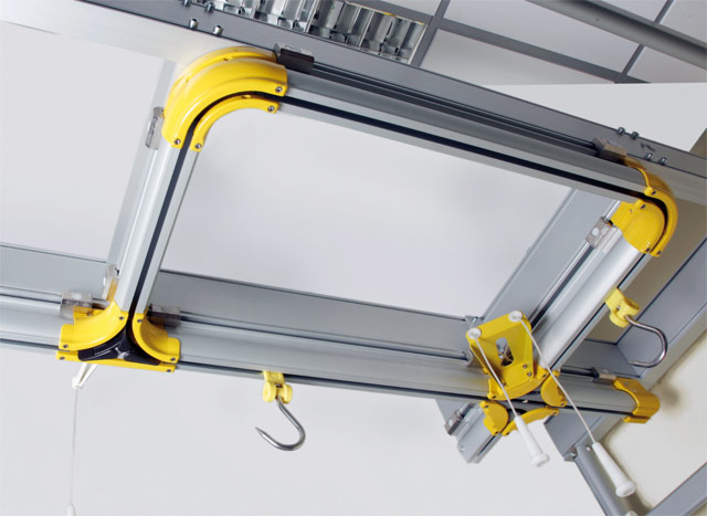 Overhead rail with meat hanging hooks